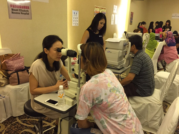 Dr Natasha Lim Event of NTUC eye screening in 2015